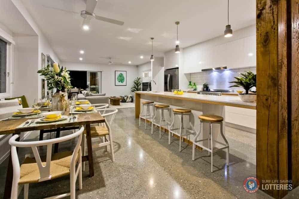 Eco Home The Osprey - The polished concrete floors seeded in white quartz created the perfect backdrop for the craftsmanship of the beautiful timber lined white kitchen joinery and the VJ lined dining bench seat